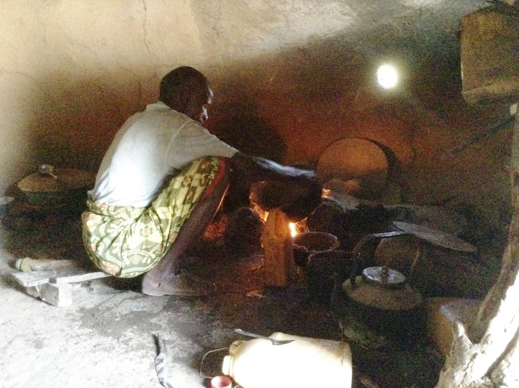 Ahmed prepares food for his children. Photo by Seble Daniel for CRS