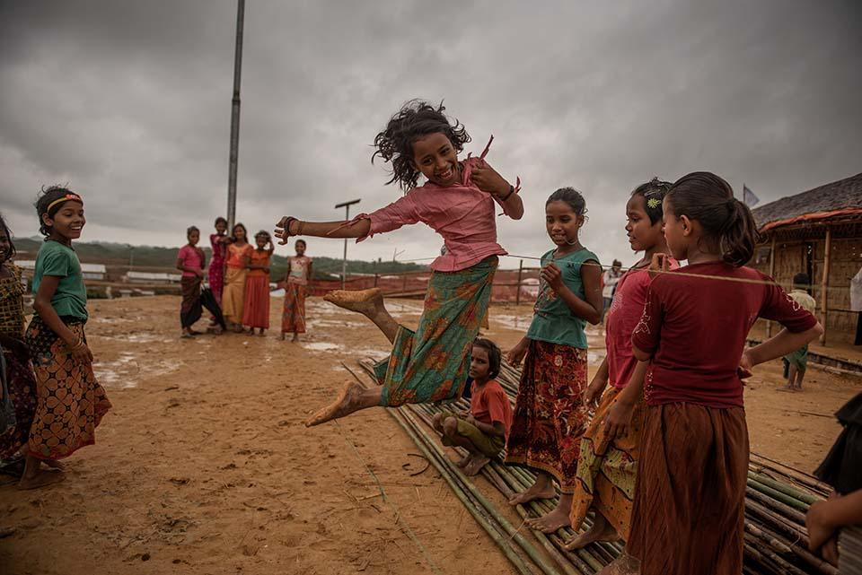 a Rohingya refugee girl plays in a camp in Bangladesh