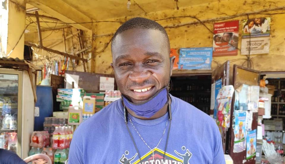 store owner in his shop in Cameroon