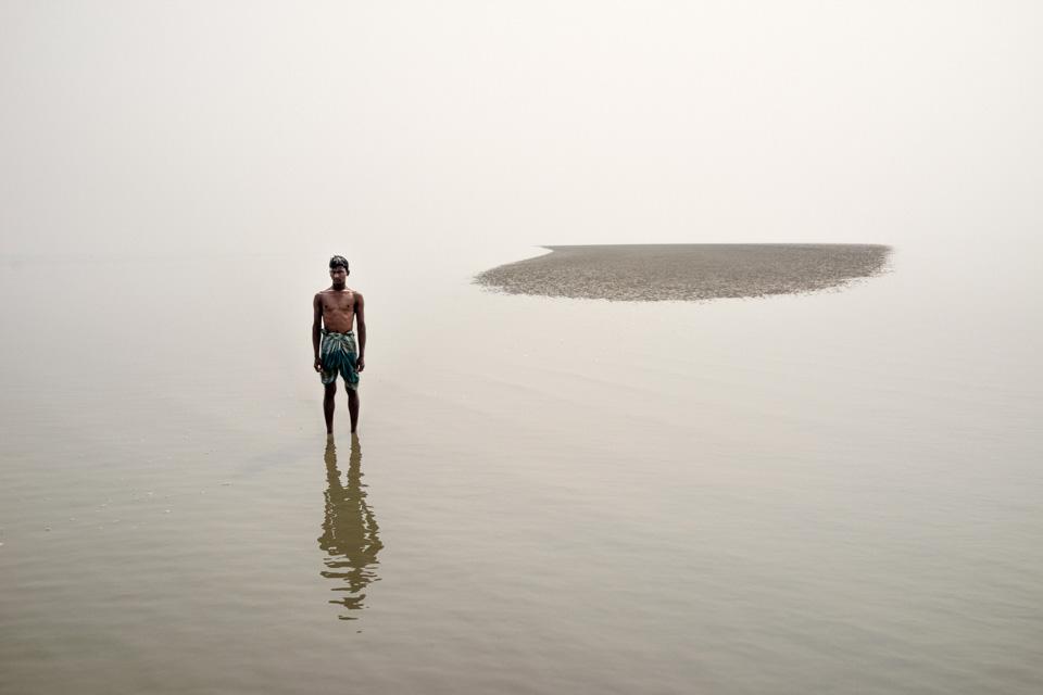 man standing in lake in Bangladesh