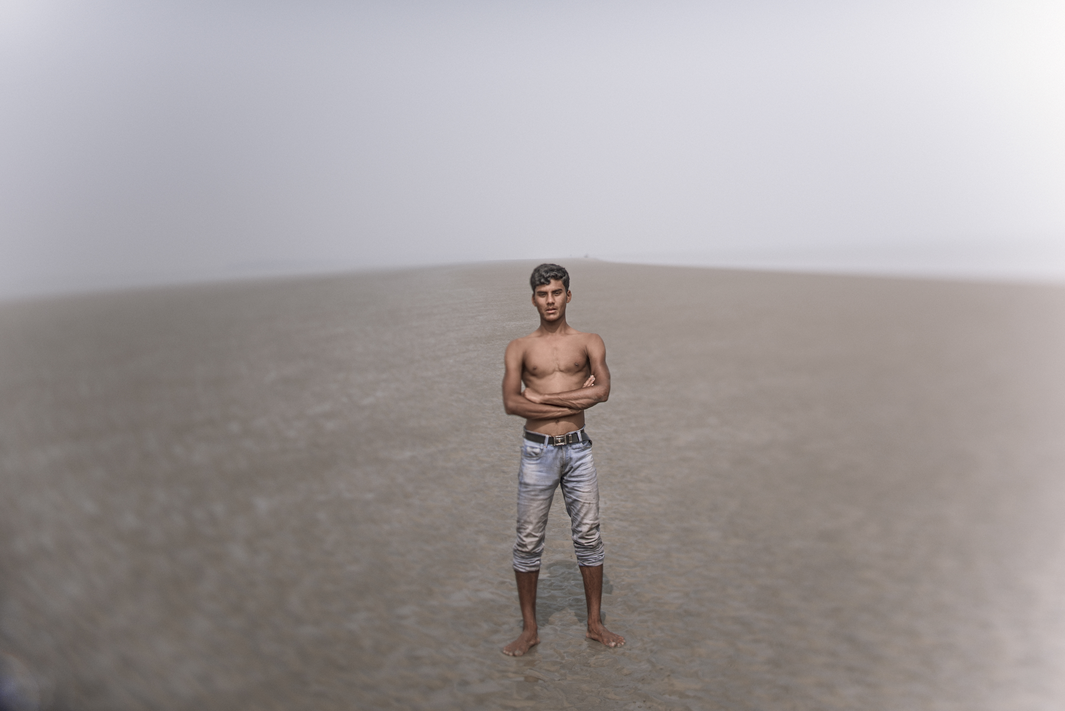 A young fisherman is pictured in Bangladesh, where rising water has caused many problems. Photo by Ismail Ferdous