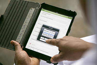 CRS provided iPads to record patient information and process invoices at health centers in Benin. Photo by Michael Stulman/CRS