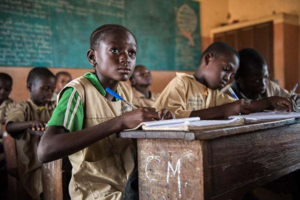 Student in classroom in Benin CRS school meal program