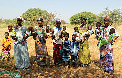 Yalgo, Burkina Faso, has a high rate of twin births—and malnutrition. These moms are thankful for the Blessed John Paul II Center, which provides nutritious food and well-baby checkups. Photo by Kim Pozniak/CRS