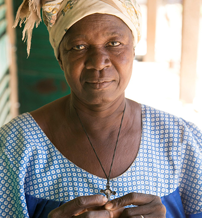 """CRS Helping Hands is feeding women like Clementine Tapsobah at the Centre Delwendé, which means \""""Relies on God.\"""" The center supports women expelled from their communities after being accused of witchcraft. Photo by Michael Stulman/CRS"""