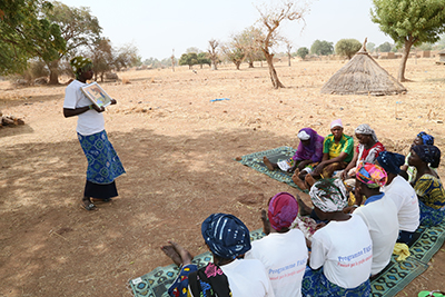 Care groups empower women to solve community problems. Photo by Michael Stulman/CRS