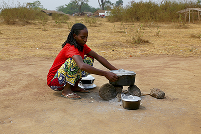 Djouleyatou Ousman cooks with kitchen supplies distributed by CRS in Eastern Cameroon. Photo by Michael Stulman/CRS