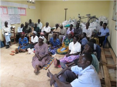 Members of the Barr Orphans, Widowers, and Widows Cooperative Society (BOWW) in their store during a training session led by Farmer-to-Farmer Volunteer Lisa Campion. Copyright Lisa Campion 2014, used with permission.
