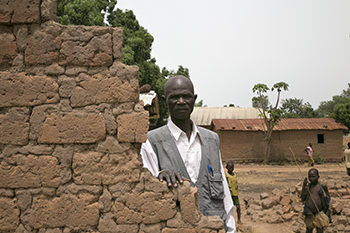 CRS has helped Marcaisse Ngoget, a village chief in Central African Republic whose home was destroyed in violent conflict, restore peace. Photo by Michael Stulman/CRS