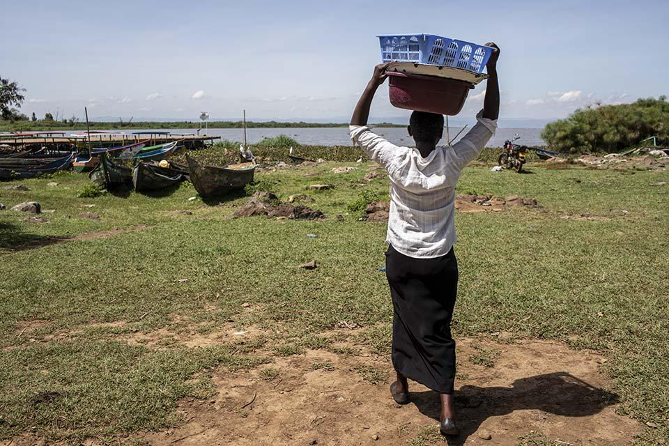 carrying fish to market in Kenya