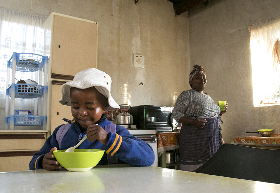 child eating in Lesotho