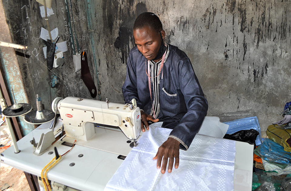 clothing maker in his shop in Nigeria