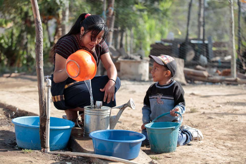 collecting water in Guatemala