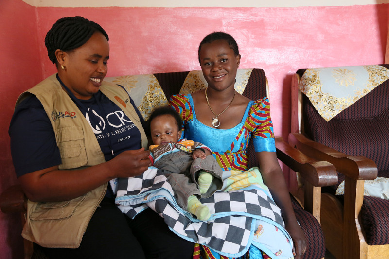 Gisele Biringanine and her daughter, Plameti Mugoli, are receiving support from community health workers trained by CRS' Afya Mama project. Photo by Michael Stulman/CRS