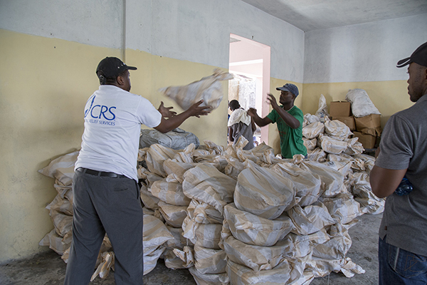 At the Catholic church in Port Salut, Haiti CRS employees load up a church dispensary with supplies for distribution to survivirs of Hurricane Matthew. Photo by Marie Arago for CRS