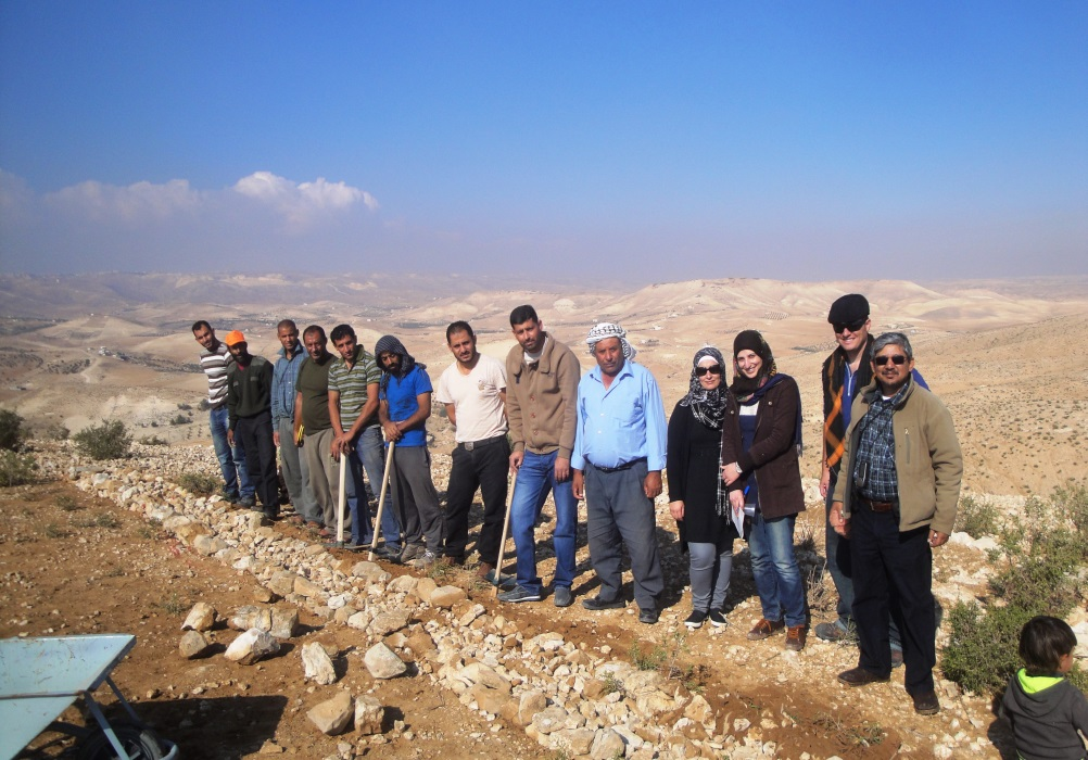 Local herders, partner organization staff and CRS staff after completing training on constructing contour walls for soil and water conservation. Fellow Daniel Pasquini-Salazar is second from right.