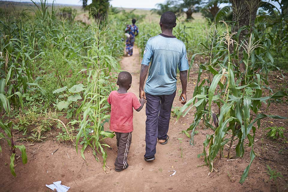 family walks in DR Congo field