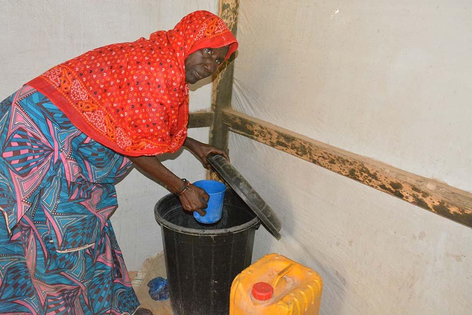 drawing water in Nigeria