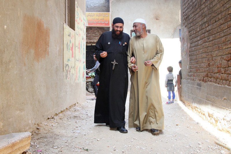 Through the CRS peacebuilding program TA'ALA, religious leaders Father Rueis, left, and Sheikh Moustafa work together to engage the faithful in interreligious dialogue in the village of Al Odayssat in Upper Egypt. Photo by Nikki Gamer/CRS