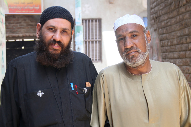 Sheikh Moustafa, right, is grateful that Father Rueis—after participating in the CRS program TA'ALA—took the first step toward rebuilding peace amid local conflict. Photo by Nikki Gamer/CRS