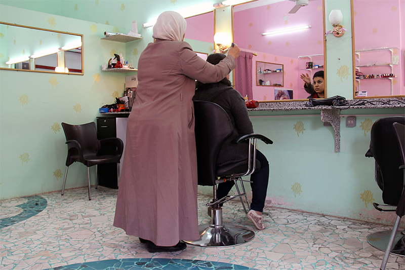 "Wafa, a Syrian, opened a salon with CRS' help. ""I'm so proud that I can cover my family's expenses. One of the best feelings is knowing that I don't need anyone to give me money; I don't need help from anyone,"" she says."
