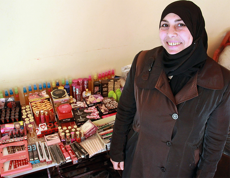 """With CRS' help, Hanadi sells cosmetics and homemade perfume to a growing clientele in greater Cairo. """"I feel like I can do anything, and that nothing is impossible,"""" she says."""