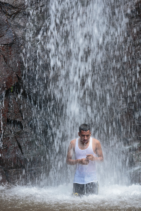 Cristian Cerén bathes in Don Juan Waterfalls, a park in Jujutla, El Salvador. CRS teaches coffee producers and processors water preservation through the Blue Harvest project. Photo by Oscar Leiva/Silverlight for CRS