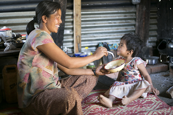mother feeds child in myanmar