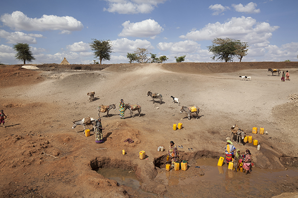Women in Ethiopia's Oromia state, where the worst drought in 50 years has left rivers and lakes completely dried out, are collecting what little water they can find. Photo by Petterik Wiggers for CRS