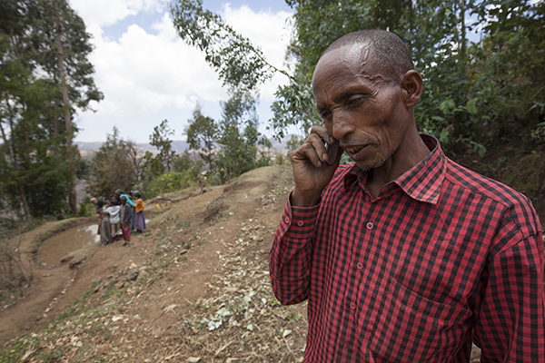 Through CRS projects, Isike and his family learned how to cultivate vegetables year-round. He also works as a weather forecaster to alert his community to changes so they can adapt their farming practices. Photo by Petterik Wiggers for CRS