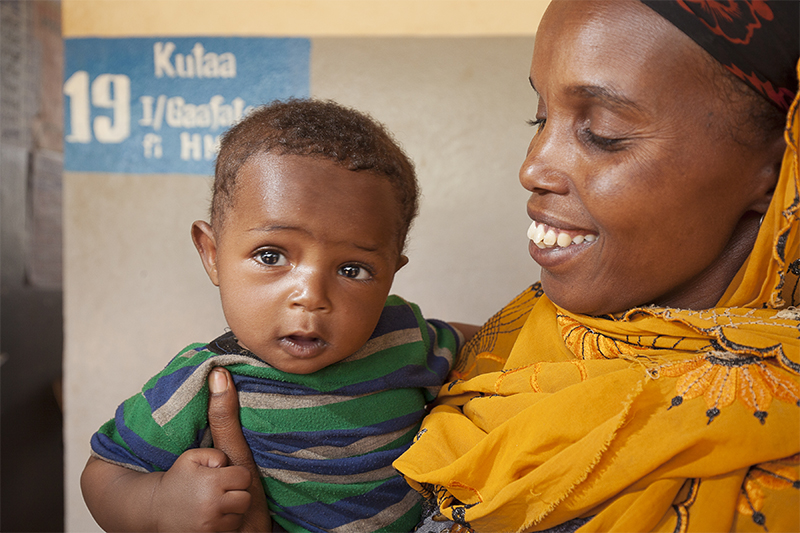 Kadija Abdelahi with her son, Amar Yusuf, 6 months.  During  worst drought in 50 years, Kadija has learned from a trained health worker the benefits of breastfeeding.