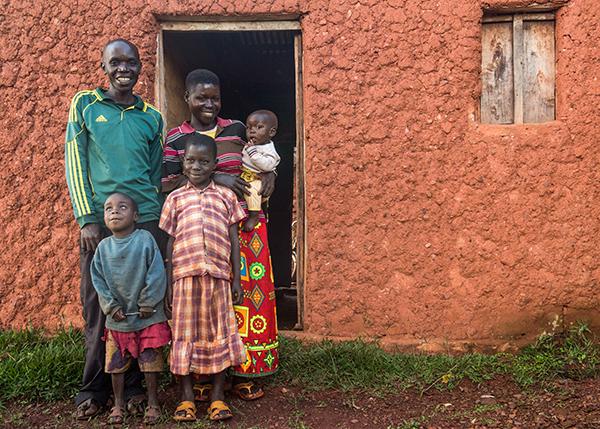 family outside home in Burundi
