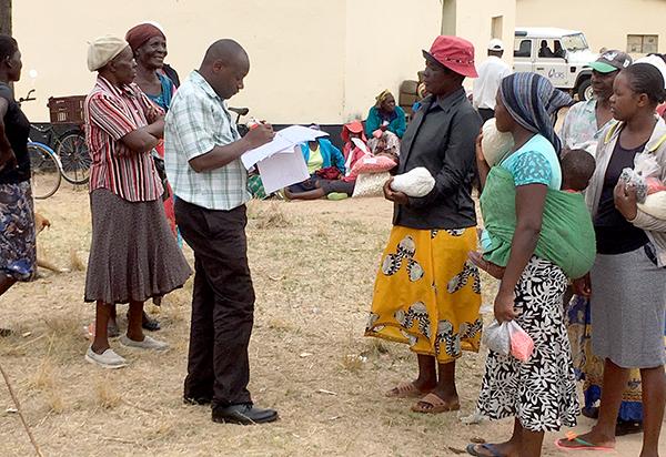 farmers in Zimbabwe receiving seed