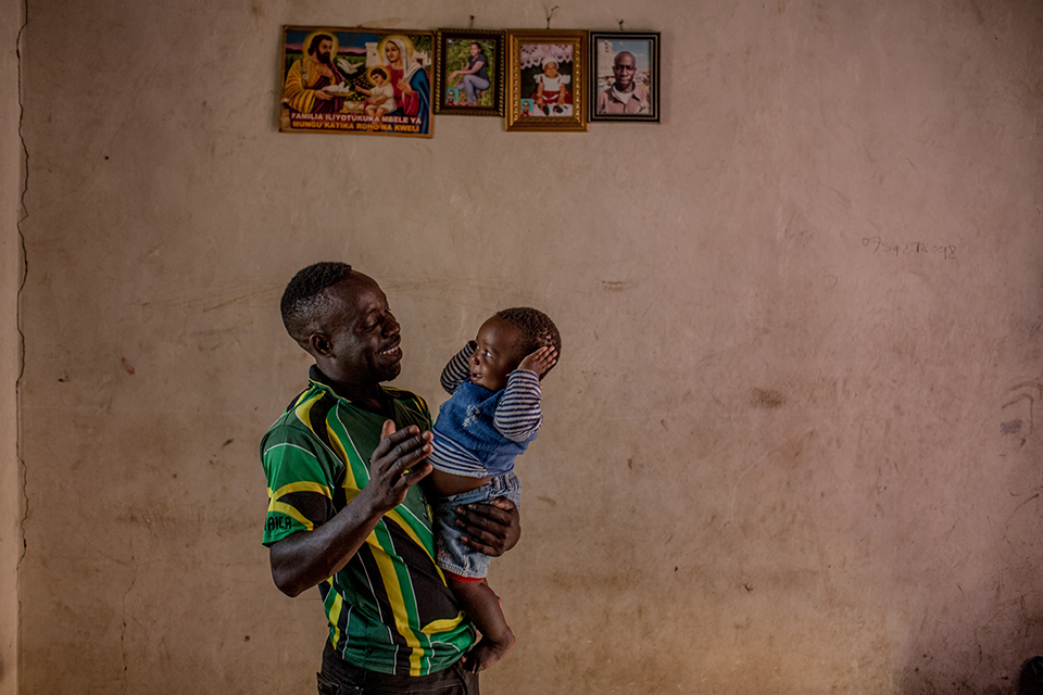 father holds daughter in tanzania