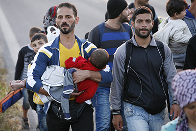 Refugees make their way toward the Greek-Macedonia border. Photo by Matthieu Alexandre/Caritas Internationalis