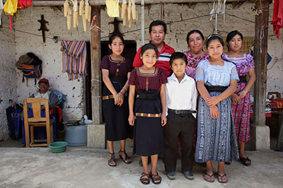 With the help of a CRS project, Miguel Angel Lopez Chan and his family see the value of educating their children, who previously skipped school to work in the family's business in Guatemala. Photo by Silverlight for CRS