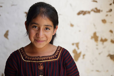 Thirteen-year-old Heidi Mariela Yuvilis 'Yuvi' Lopez Ixcoteyac used to spend much of her time sewing t-shirts for her family's garment-making business in Guatemala. Now, she will be the first in her family to attend middle school. Photo by Silverlight for