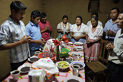 The Ramirez family of Guatemala, who benefited from a CRS agriculture program, prays before dinner. We're grateful to work with families like theirs all around the world. Photo by Silverlight for CRS