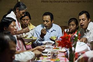 The Ramirez family of El Guabayo, Guatemala gathers in joy for a family meal.