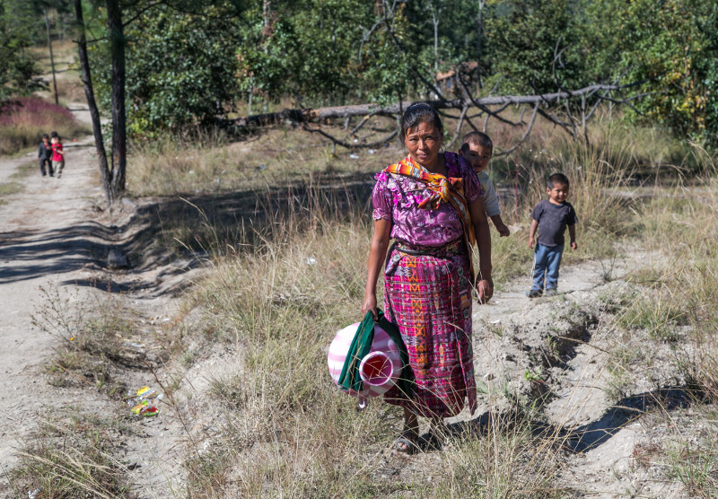 Cristina Garcia and her family walk to get water for drinking, cooking and cleaning.