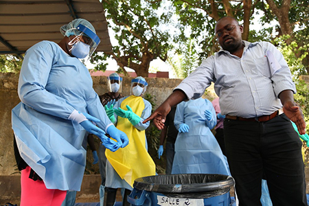 CRS training provides practical experience on how to put on and take off protective equipment, and how to manage and properly dispose of waste. Photo by Michael Stulman/CRS