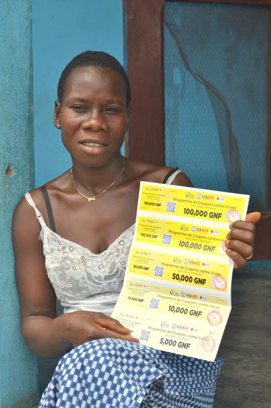 """Lucette Valerie Korouma, an Ebola survivor from Guinea, says """"life will be better"""" with the food vouchers she received from CRS and our local Caritas partner, OCPH-Nzérékoré. Photo by Corrie Sissons/CRS"""