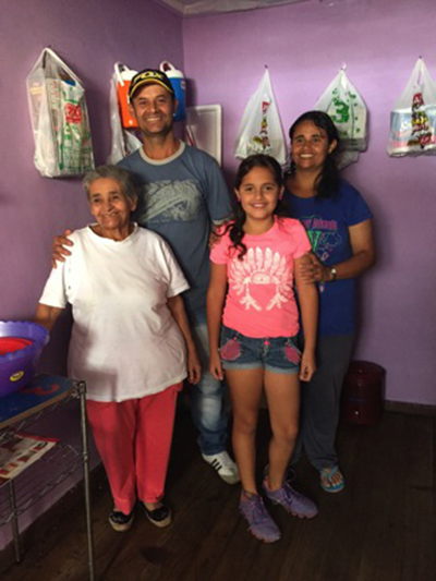 Gustavo, his sister Martha, niece Luisa and mother, Clara, are Colombian refugees living in Ecuador. Photo by Lucy Steinitz/CRS