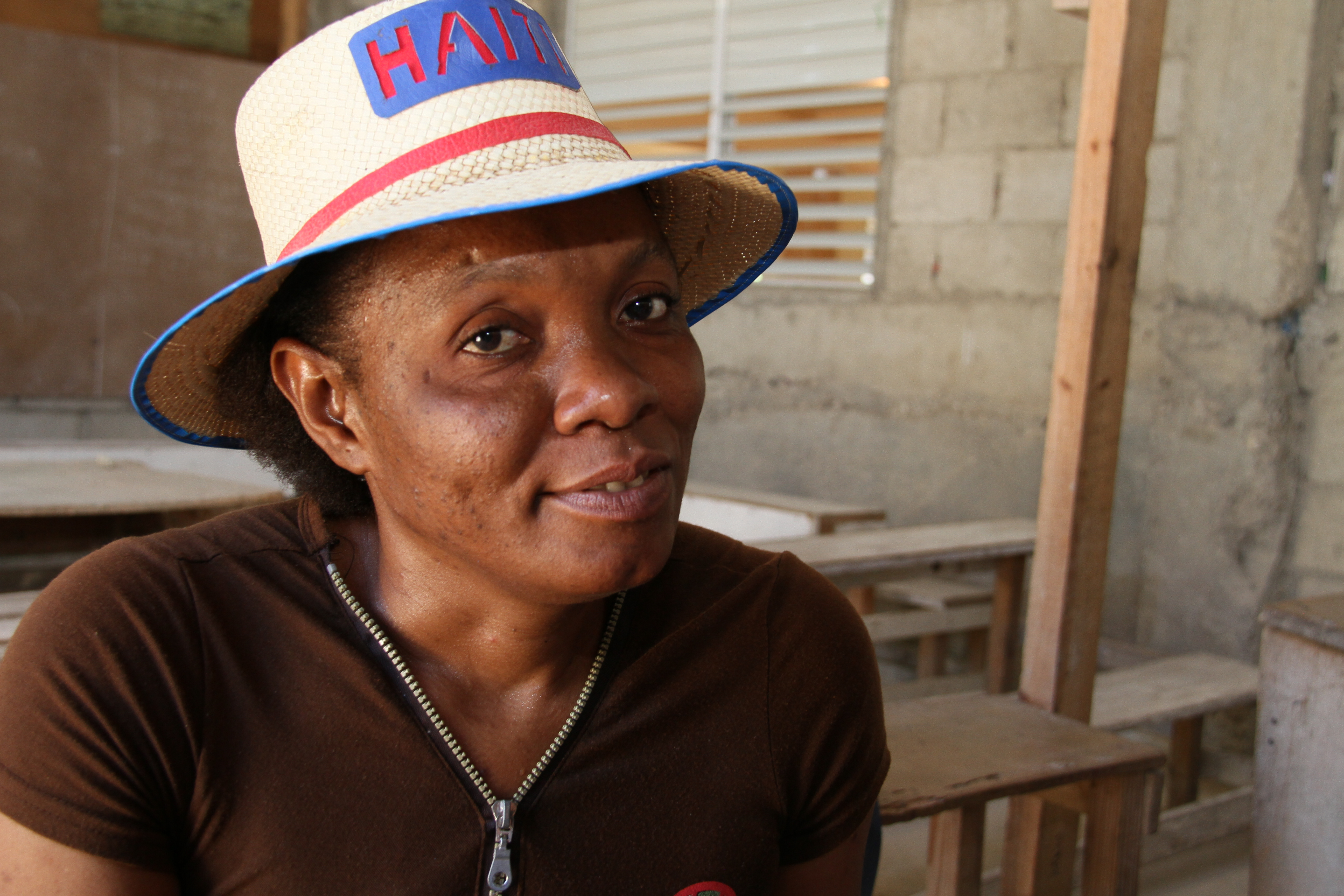 """Marie Jeanine Julien, a member of the \""""star\"""" SILC group, is building a better community. Photo by Tom Price/CRS"""
