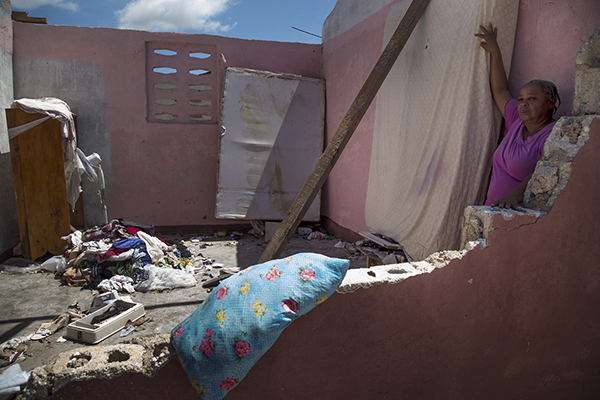 Bernadette Moses' home in Port Salut, Haiti, was destroyed by Hurricane Matthew. On the night of storm Bernadette took shelter in a field, afraid her house would collapse on her. , Photo by Marie Arago for CRS
