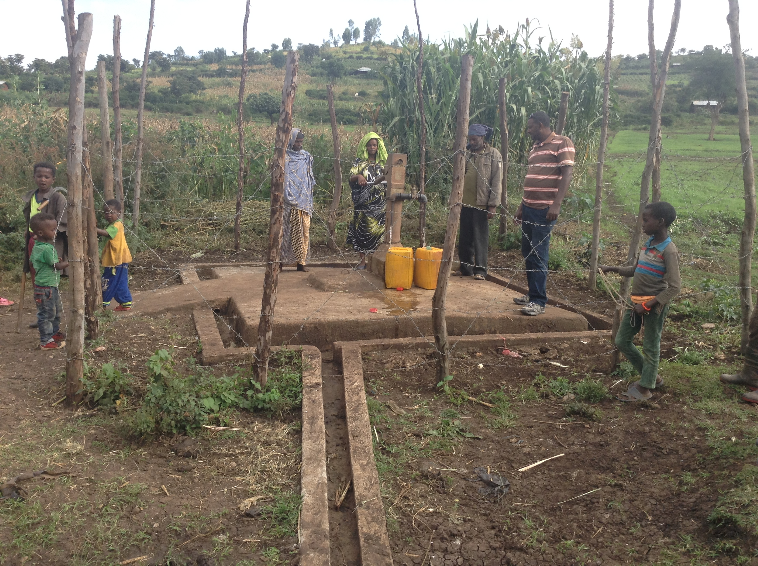 Community members examine their hand-dug well. Photo by Gutu Kenesa for CRS