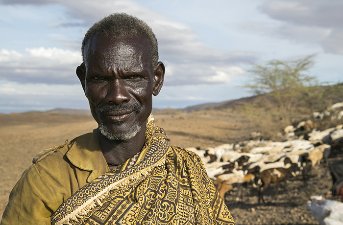 Herder seeks pasture for his goats during prolonged Kenya drought