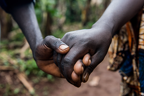holding hands in Burundi