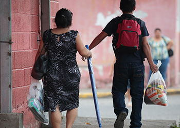 Migrants carry basic supplies offered by a care center in Honduras. Increasing desperation has led many people and children to flee their homelands. Photo by Oscar Leiva/Silverlight for CRS.