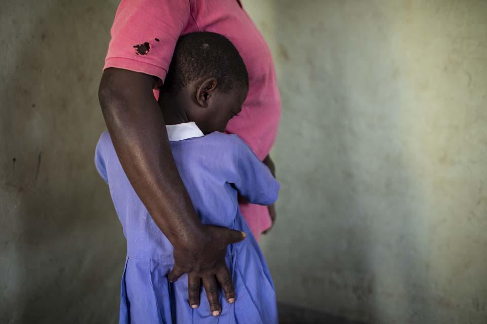 mother and daughter hug Uganda